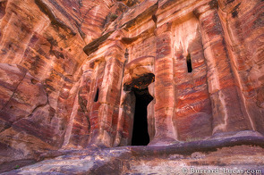 A tomb carved into the colourful sandstone. The slits on either side of the door are a later crusader addition.