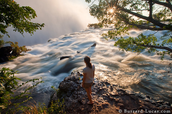 Edge of the Earth: Nat looking out over the falls at sunset.